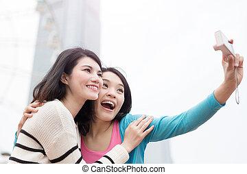 two woman selfie in hongkong - two beauty woman smile...