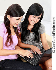 two woman with laptop
