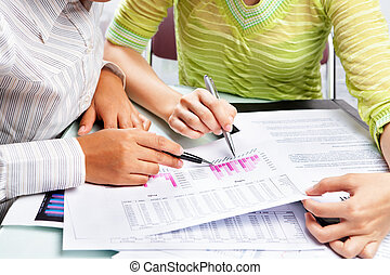 Two woman working on statistic