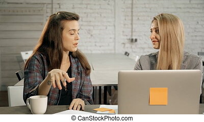 Two woman working together and planning new startup - Two...