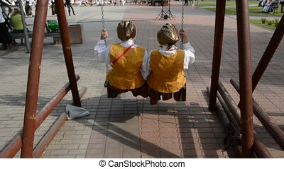two womans swinging in the summer fair place