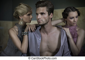 Two women and an handsome guy