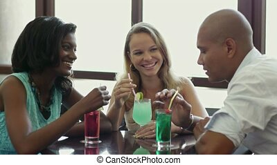 Two women and man having fun in pub