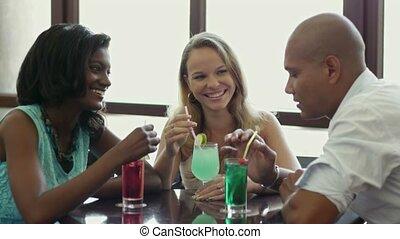 Two women and man having fun in pub