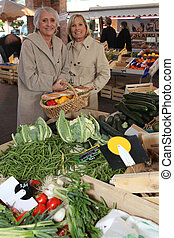 Two women at local market