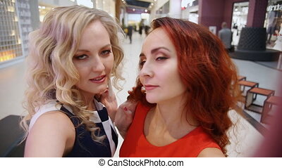 Two women at the mall take selfie