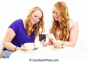 two women busy with a smartphone