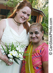 Two women - Canadian woman with an Indian woman on a formal...