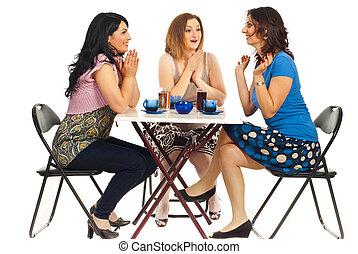 Two women congratulate their friend