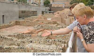 Two women discussing ruins of Serdica in Sofia