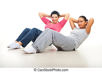 Two women doing abs