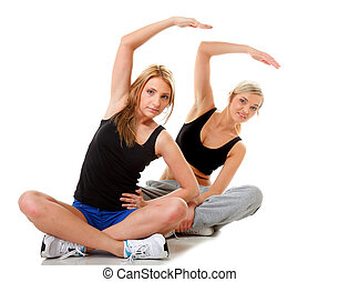 Two women doing fitness exercise isolated