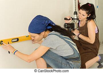 Two women doing home renovations