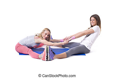 Two women doing yoga stretching