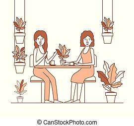 two women drink coffee in the garden