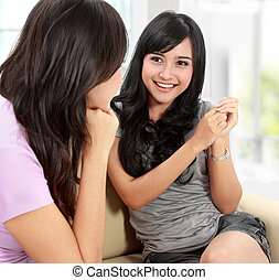 Two women friends chatting