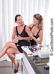 two women getting ready for the evening