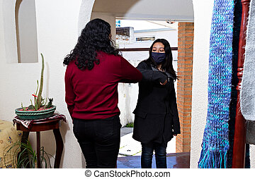 Two women greeting each other