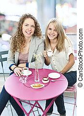 Two women having coffee
