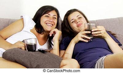Two women having fun watching tv