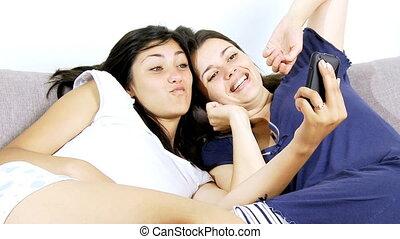 Two women having fun with selfie