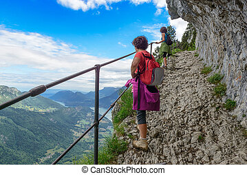 Two women hikers walking in the mountains