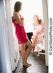 Two women in a bathroom