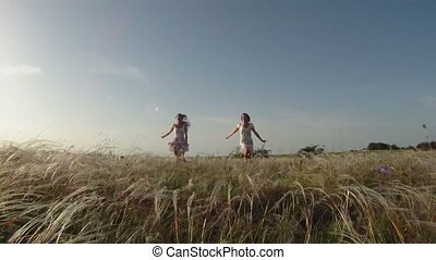 Two women in a field