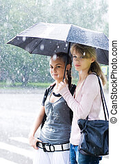 Two women in a rainy weather