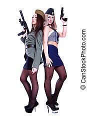 Two women in a vintage military uniforms with guns