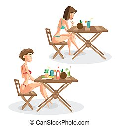 Two women in bikini sitting at a table with fruits and...