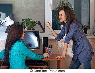 Two women  in office