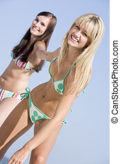 Two women in two piece bathing suits