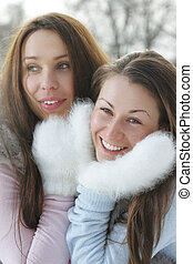Two women in white mittens