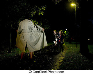 Flasher at night - Two women laughing at a Flasher at night ...