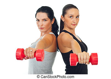 Two women lifting barbell