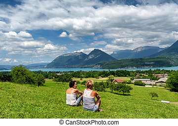 two women looking at Annecy lake in France