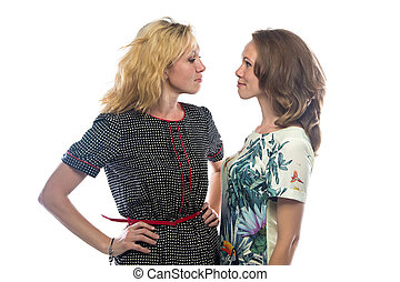 Two women looking at each other on white background