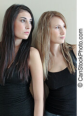 Two women looking off to the side