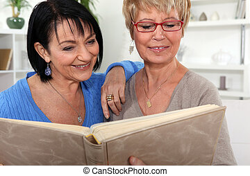 Two women looking through a photo album