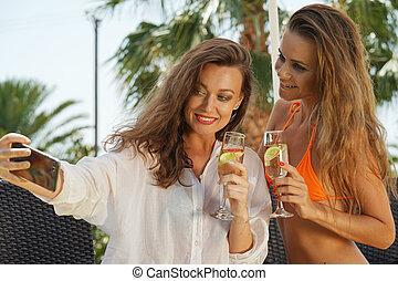 Two women making selfie