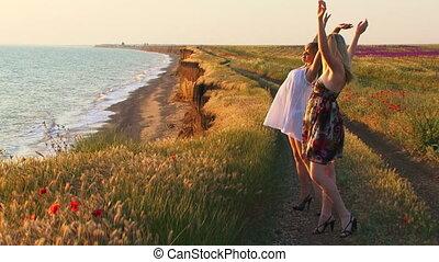 Two women near the sea