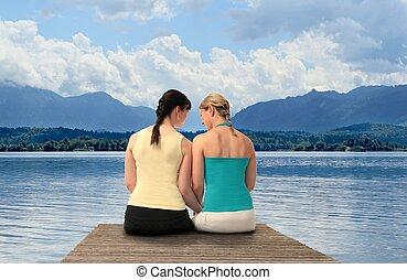 Two Women on a lake