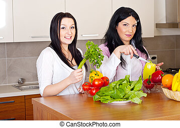 Two women prepare the dinner