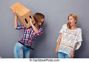 Two women quarrel