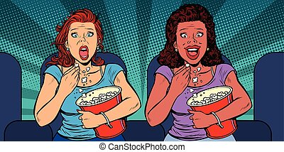 Two women react differently to the movie. laughs and fears