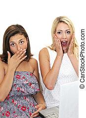 Two women reacting in shocked awe - Two women reacting in...
