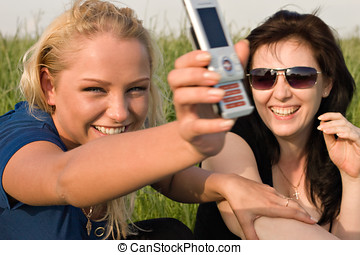 Two women reading sms