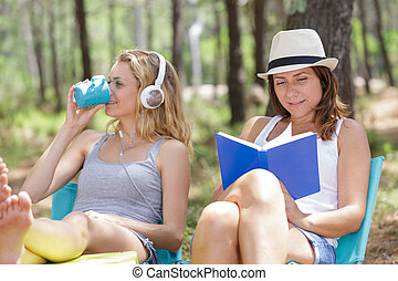 two women relaxing in the forest
