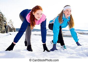 Two women running outdoors